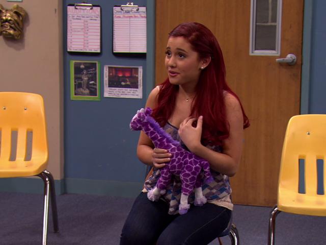 File:Cat in a screen shot with her purple giraffe.png