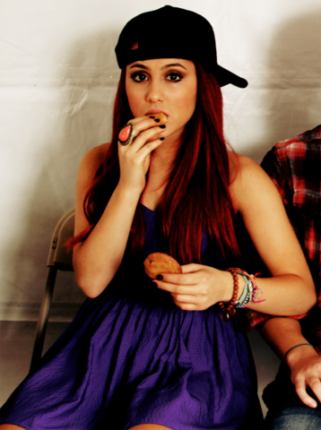 File:Ariana with a caps eating cookies.png