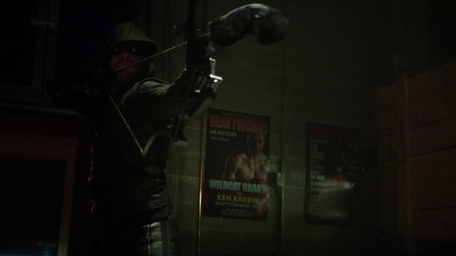File:The Arrow aims a boxing glove arrow.png
