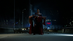 Superman carries an injured Supergirl.png