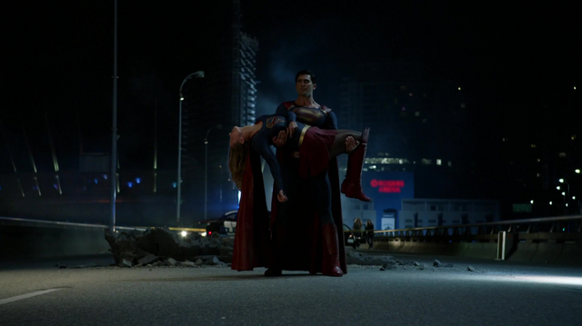 File:Superman carries an injured Supergirl.png