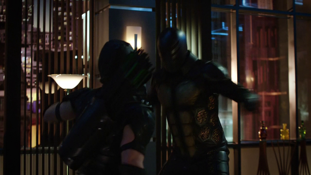 File:Green Arrow fights the bee-man.png