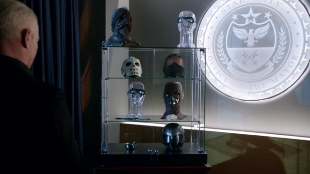 File:Damien Darhk with his trophies.png