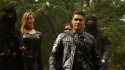 Adrian Chase, Black Siren, and Evelyn Sharp confront Team Arrow on Lian Yu