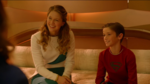 Kara and Kal sitting on the bed talking to Alura and Zor-El