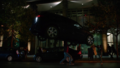 Mon-El stops a car.png