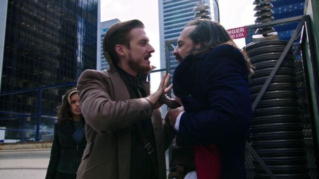 File:Rip Hunter holds the knife in to Vandal Savage.png