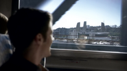 Barry Allen on a train ride, viewing S.T.A.R. Labs from afar