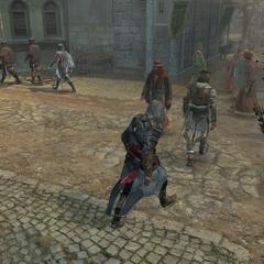 Ezio volgt Yusuf langs de <a href=