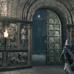 Ezio bij de ingang naar de basiliek.