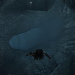 Aveline swimming through an underwater cave