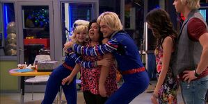 Trish hugged by Billie & Bobbie