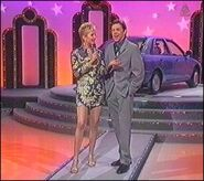Rob Elliott and adriana xenides on wheel of fortune late 90s