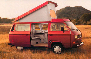 Red vanagon in field