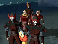 The guards escort Aang to the prison hold