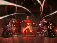 Aang airbends at door
