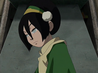 Toph looks away