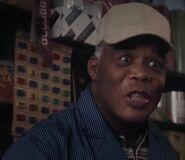 Oscar James as Shopkeeper