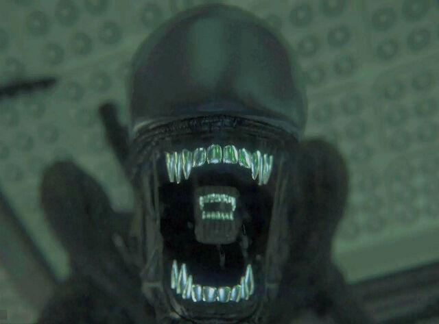 File:AI Alien Head Biting player.jpg