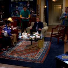 The upset doctor is getting a hot beverage from Sheldon.