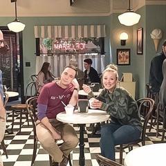 Penny and Sheldon having ice cream.