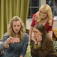 Penny, Amy, and Bernadette watch something from Penny's phone. (Not in final episode edit.)