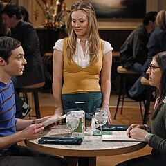 Sheldon and Amy on their date at the Cheesecake Factory with Penny as their waitress.