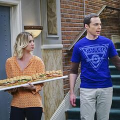Penny and Sheldon retreating to Penny's apartment.