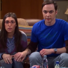 Unconsciously Sheldon takes Amy's hand.