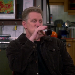 Kenny drinking beer.