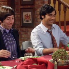 Raj and Howard smiling during dinner.