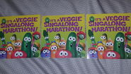 On the back side of VeggieTales 150 All-Time Favorite Songs, It has Bob, Larry, Junior, Laura, Petunia, Archibald, Phillipe, Jean Claude, Madame Blueberry and Jimmy and Jerry