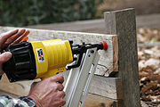 250px-Using a nail gun