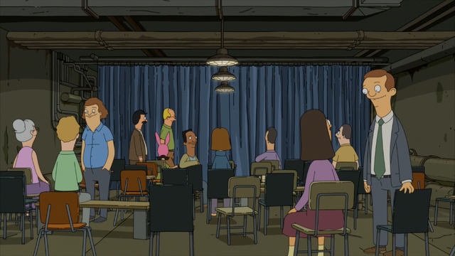 File:S5E01.143 People at the Die Hard Muscial.png