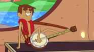 Danny playing banjo with his feet