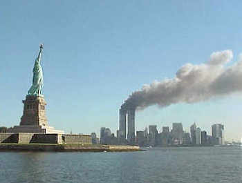 File:National Park Service 9-11 Statue of Liberty and WTC fire.jpg