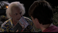 Doc giving Marty the walkie talkie.png