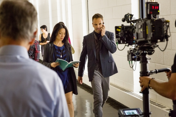 File:005 Solve for X behind the scenes photo of Lucy Liu and Jonny Lee Miller.jpg