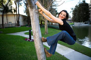 Deirdre Shannon climbing a tree