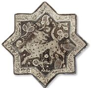 Kashan lustre-decorated star tile, Central Persia, circa 1300, Christie's sale 2835 Dec. 2009
