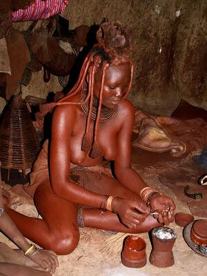 Himba lady preparing deodorant