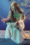 Carrie White at the prom with her bouquet