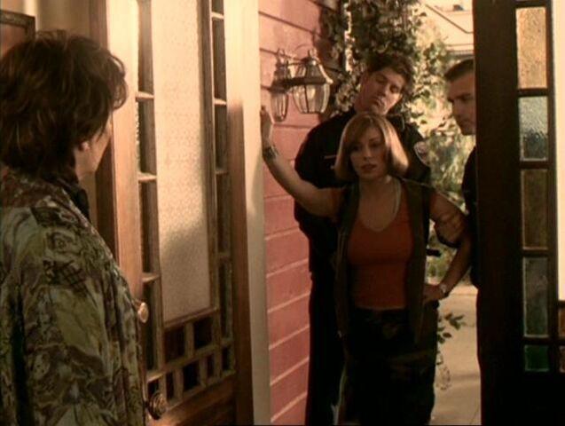 File:Phoebe-escorted-cops.jpg