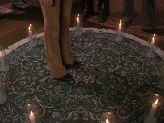 File:Prue stands in a circle of candles.jpg