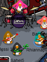 File:Unknown Band member without a grass skirt playing guitar with G Billy and Petey K playing guitar, and Stompin' Bob and Franky playing drums.PNG