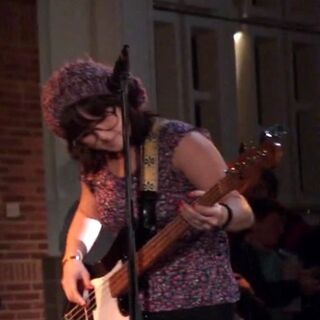 <center><b>Bassist</b></center>Unnamed Asian woman who played the bass for the band.
