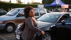 Shirley walks past Pierce's Mercedes