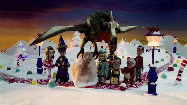 File:S02E11-Christmas Pterodactyl removes Shirley.jpg