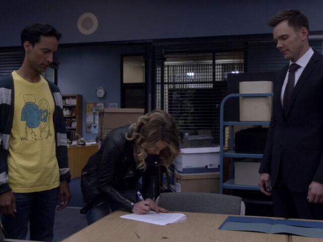 File:5x01-Britta signs Abed Jeff.jpg