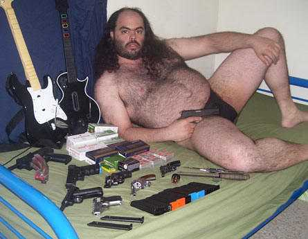 File:Weird-guy-with-guns.jpg